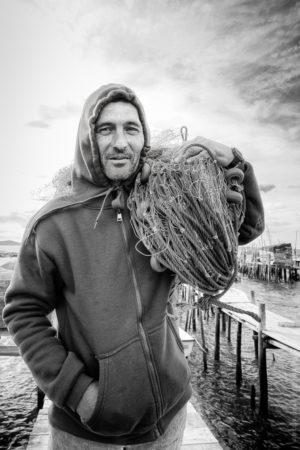 Alvaro, Un marin portugais pêchant entre mer et fleuve.
